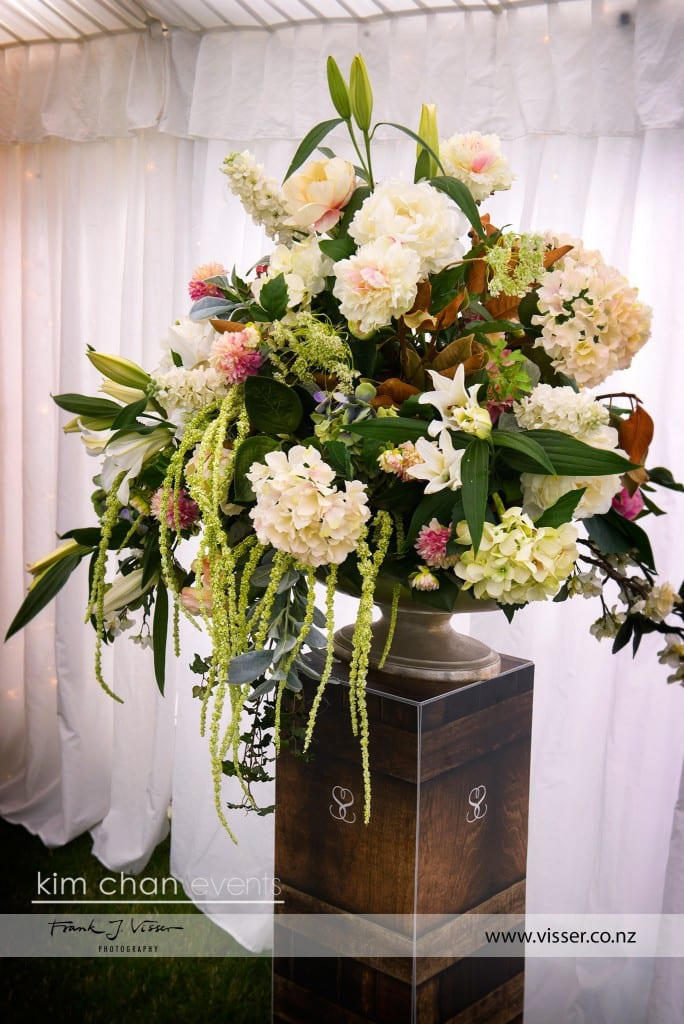 Floral arrangements in large vase on standing box