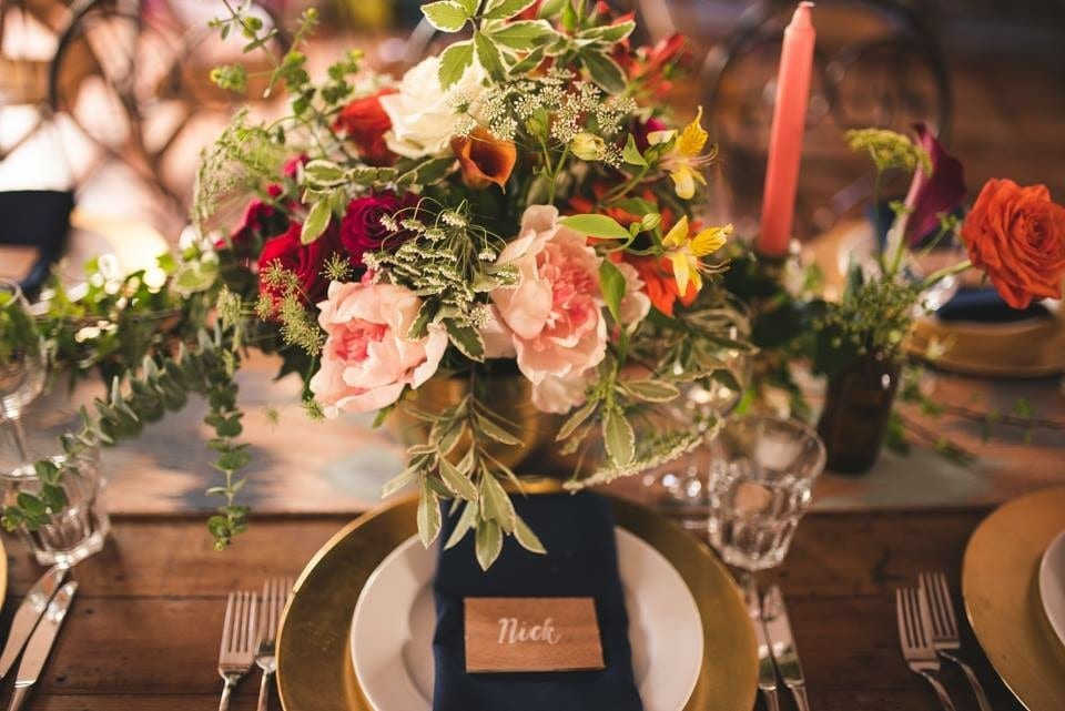 bowl of summer flowers for wedding table, in coral gold and navy theme, by florist Kim Chan