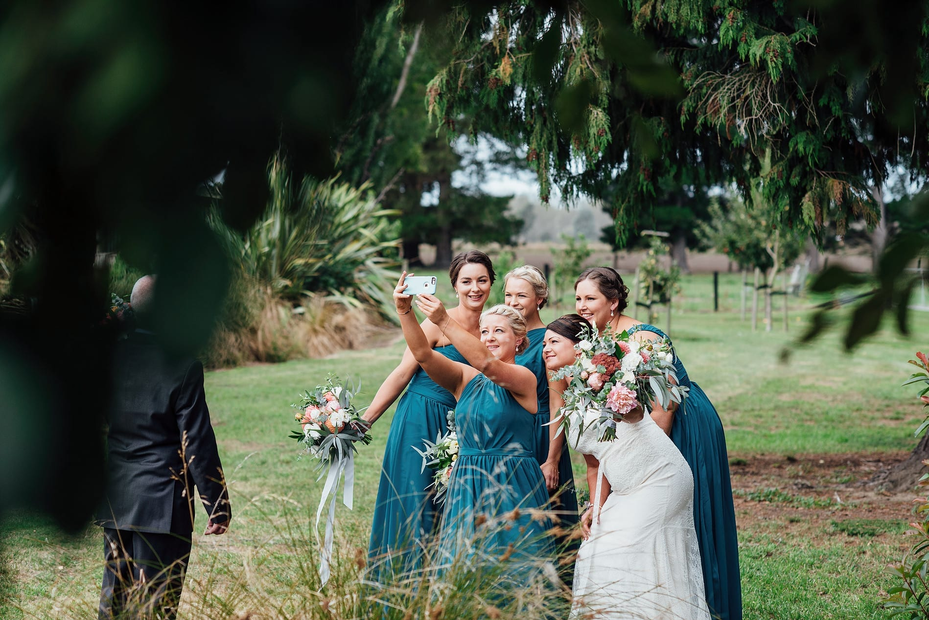 Bride and bridesmaids taking time out with a selfie!