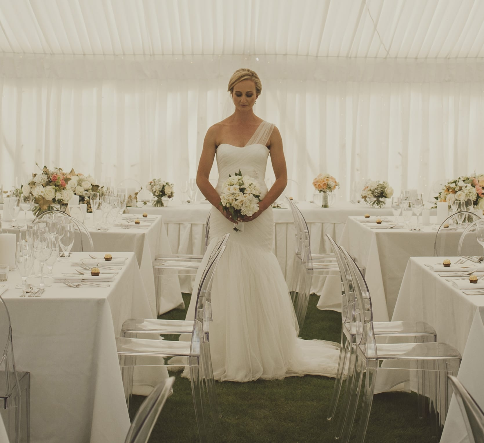 kim chan events | our bride enjoying her bouquet and flowers in the marquee