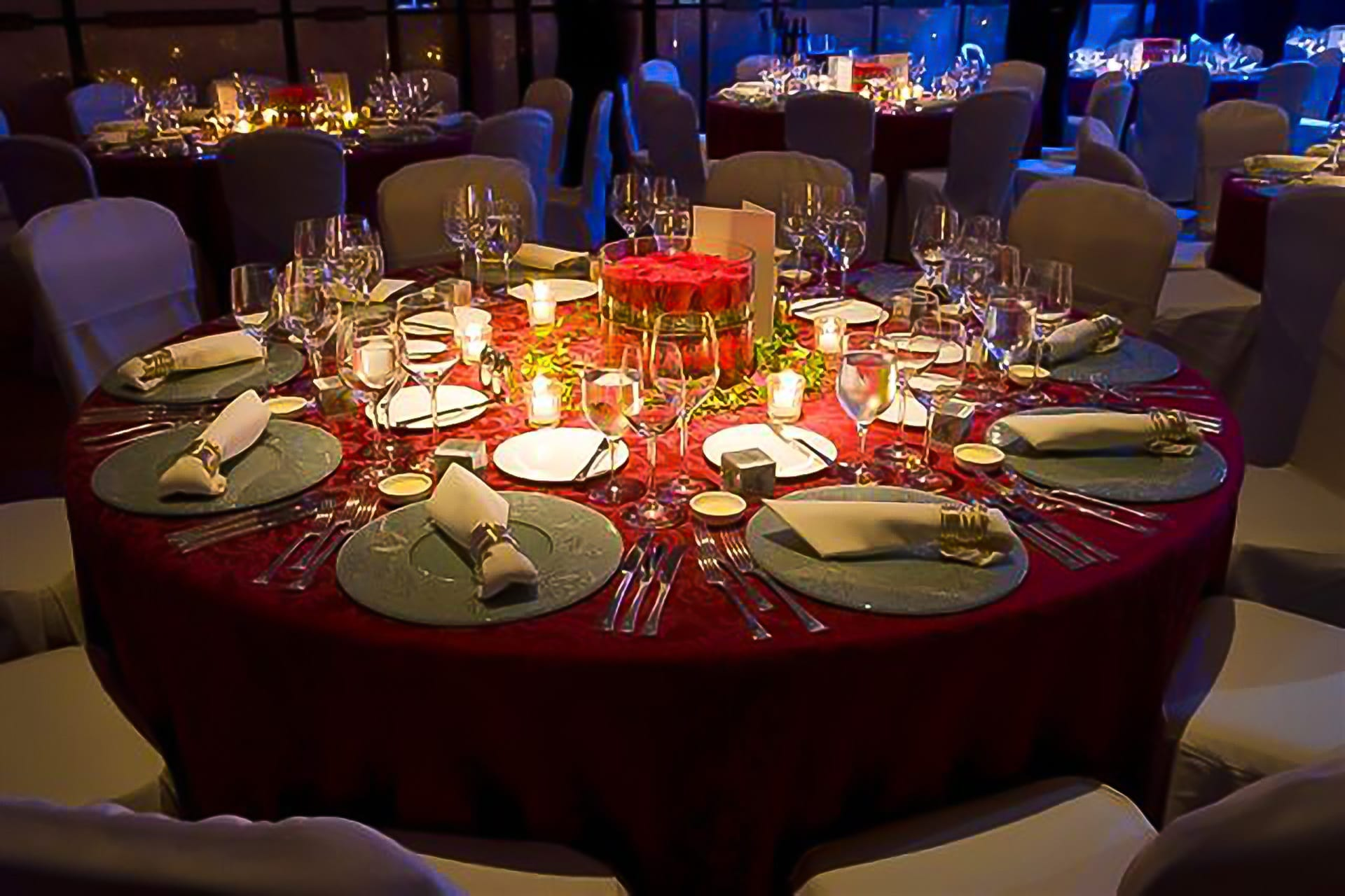 Kim Chan Events|Gala Dinner featuring red rose table centrepieces and candles