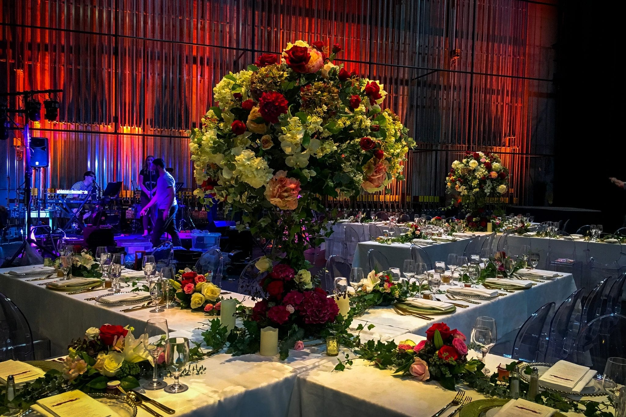 Kim Chan Events| candelabra style arrangements, laid out off tables in X format,  Isaac Theatre Royal Christchurch
