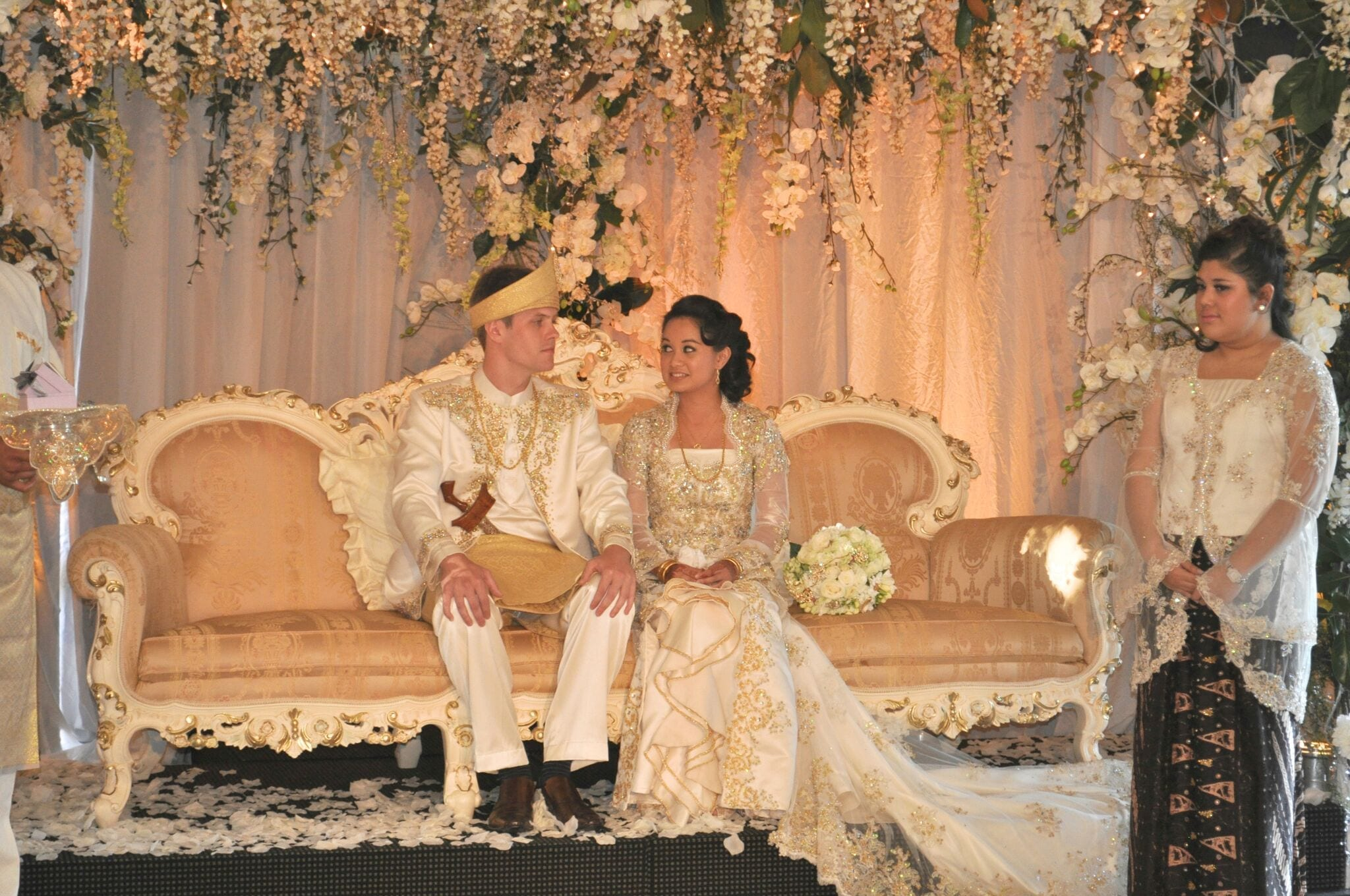 Kim Chan Events| Muslim weddings ceremony, bride and groom under floral arbour, on sofa with flowers all around and bridal bouquet of roses and freesias