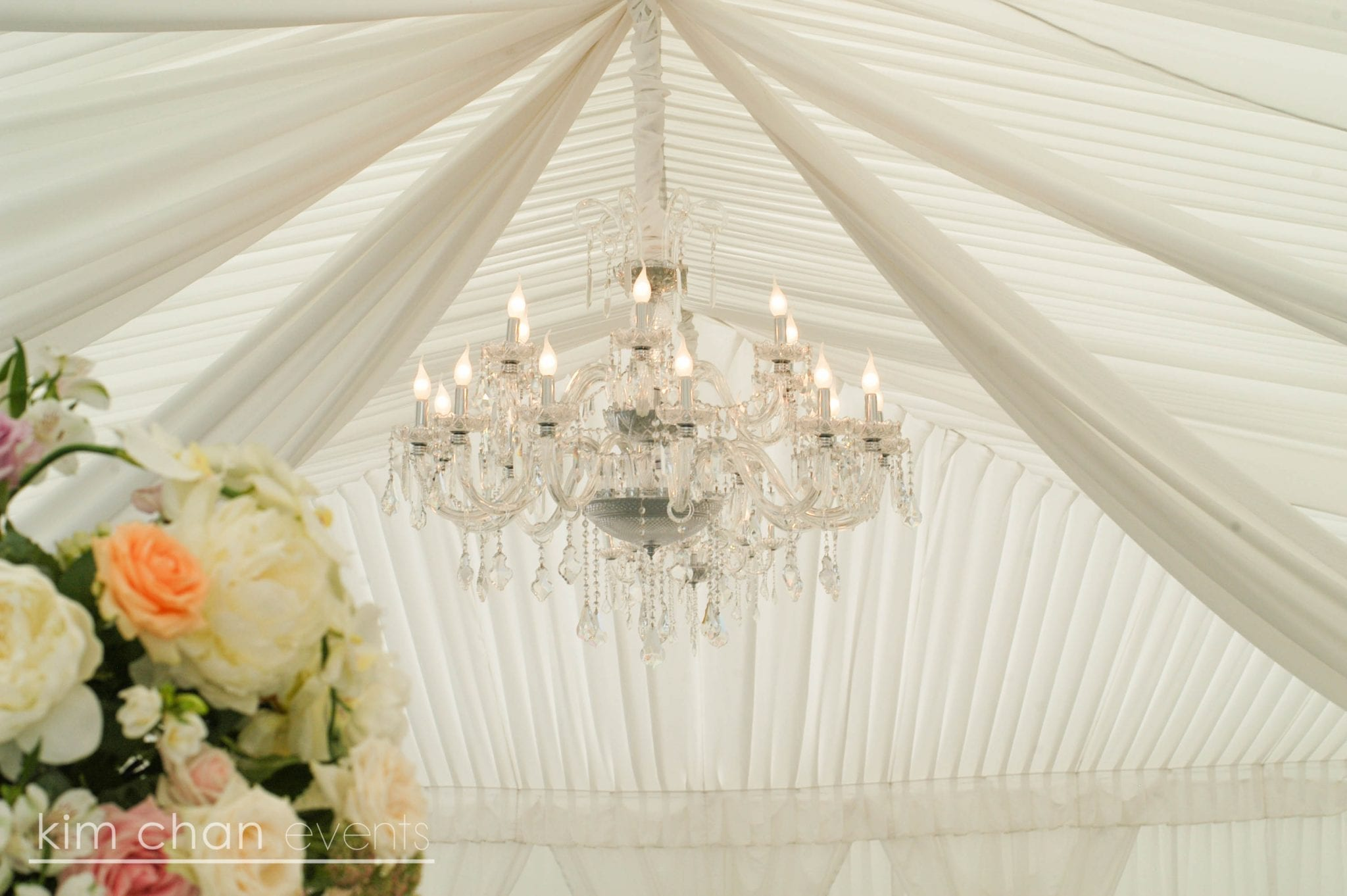 Kim Chan Events| Double Layer Chandelier, in marquee with peach pink and white flowers,