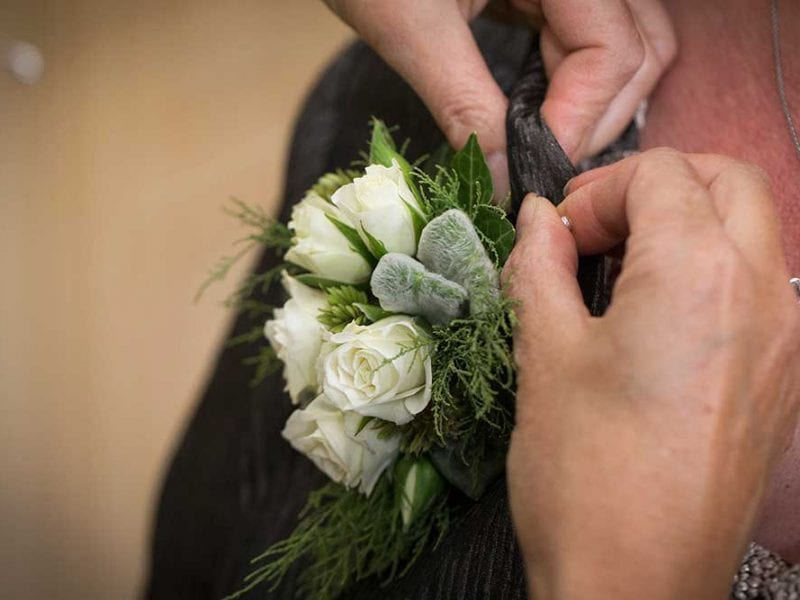 Pinning on a buttonhole