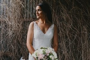 Beautiful bride with bouquet by Kim Chan Events