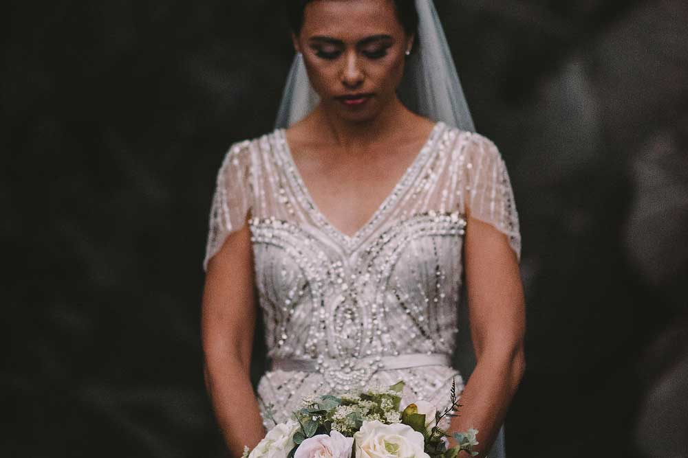 Beautiful bride with her bouquet | by Kim Chan Events
