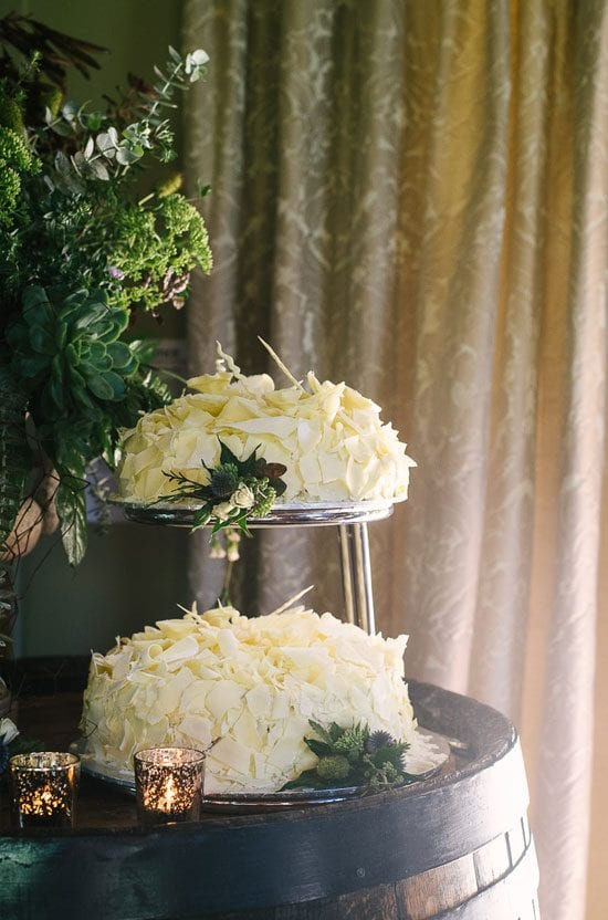 Wedding flowers decorating the wedding cake by Kim Chan Events