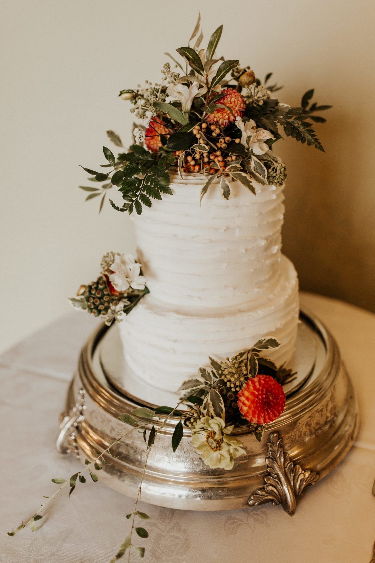 Beautiful layered wedding cake with flower decorations