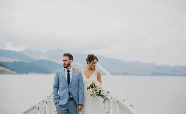 Bride and groom with lake and mountains behind