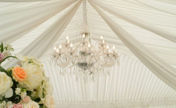 Chandelier hanging in marquee