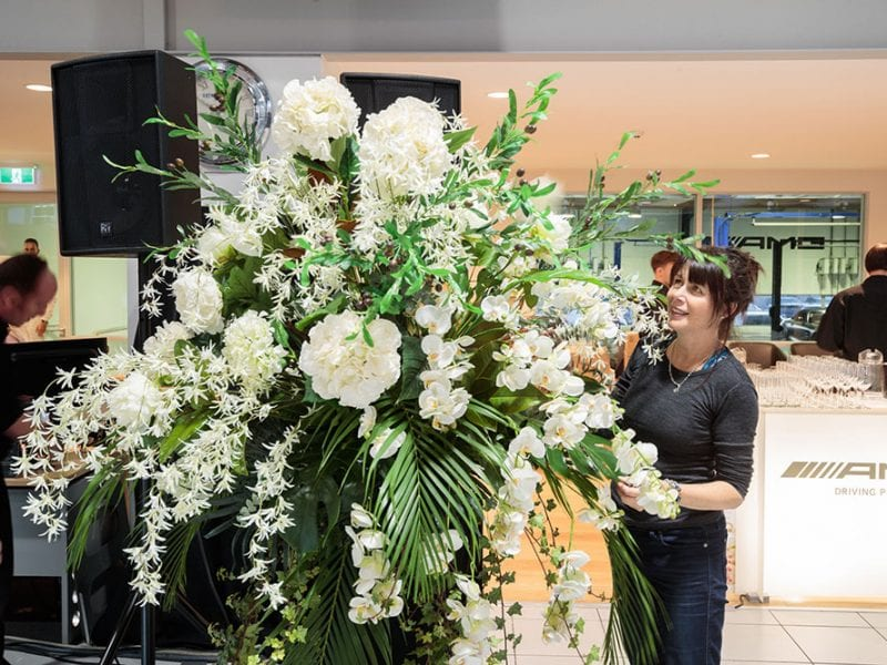 Kim creating the floral arrangements for the AMG Showroom Launch