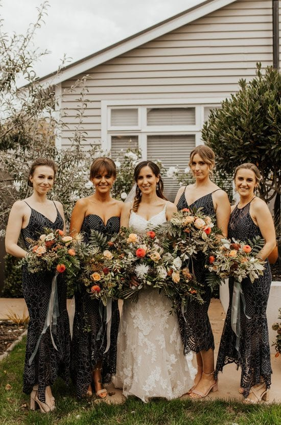 Bride and bridesmaids with their bouquets by Kim Chan Events