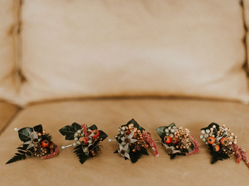 Stunning autumn themed buttonholes by Kim Chan Events.