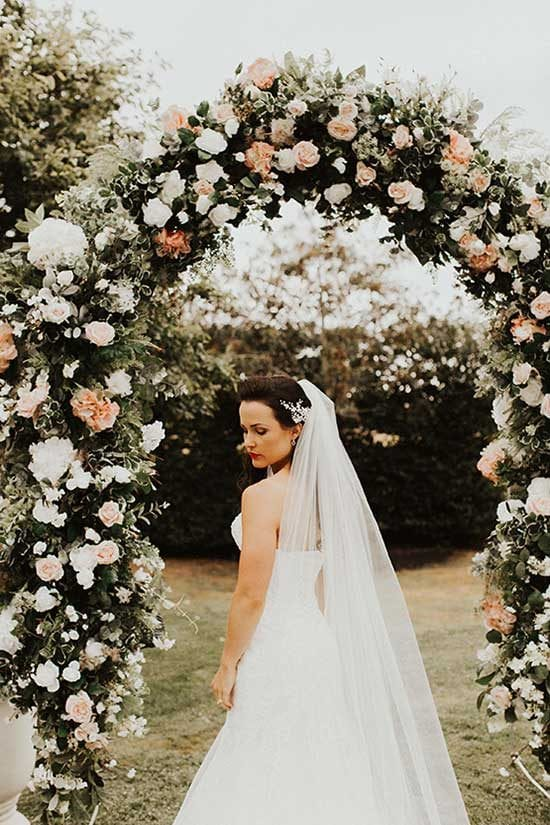 Beautiful bride with her wedding arch