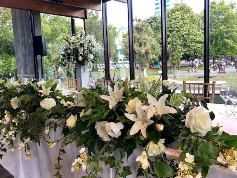 Beautiful flower arrangements for the Christchurch Town Hall by Kim Chan Events