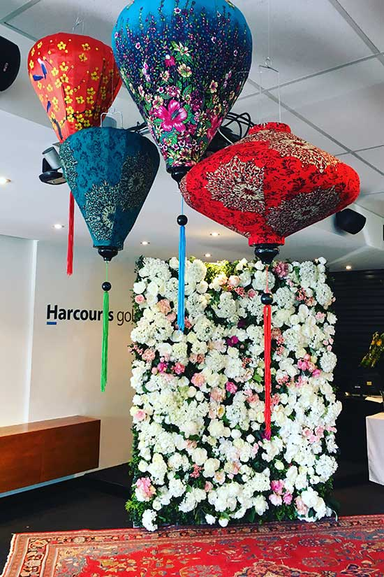 Harcouts Gold celebration with flower wall