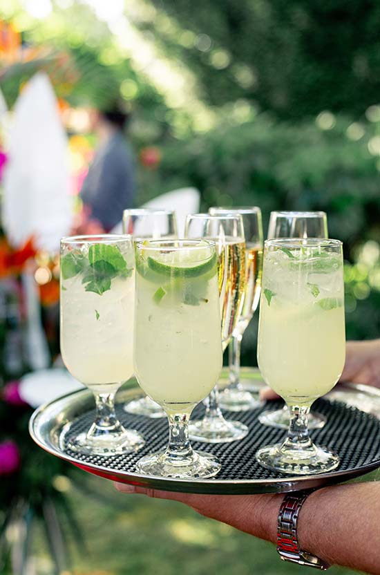 Bubbles and drinks at tropical themed party
