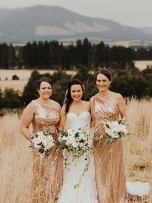 Bride and 2 bridesmaids with their wedding flowers