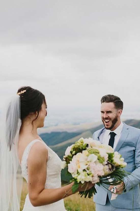 Happy bride with her wedding bouquet and groom
