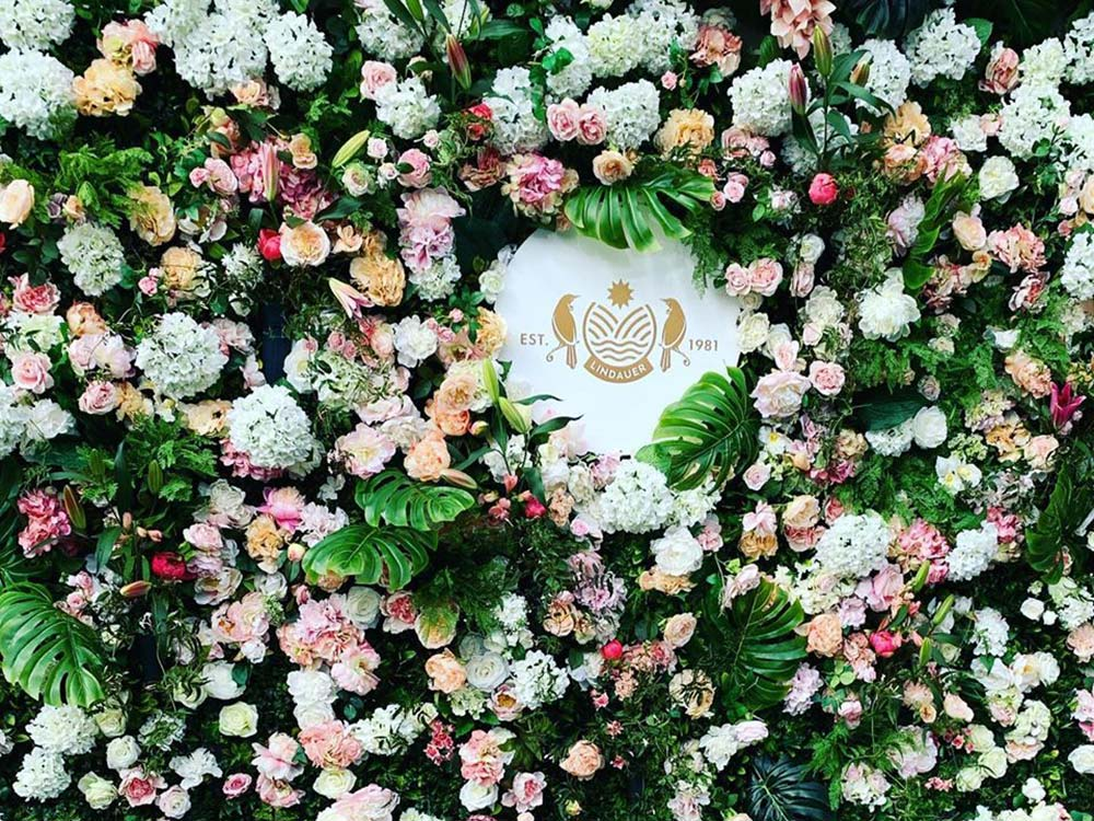 Cup and Show Week Flower wall with logo