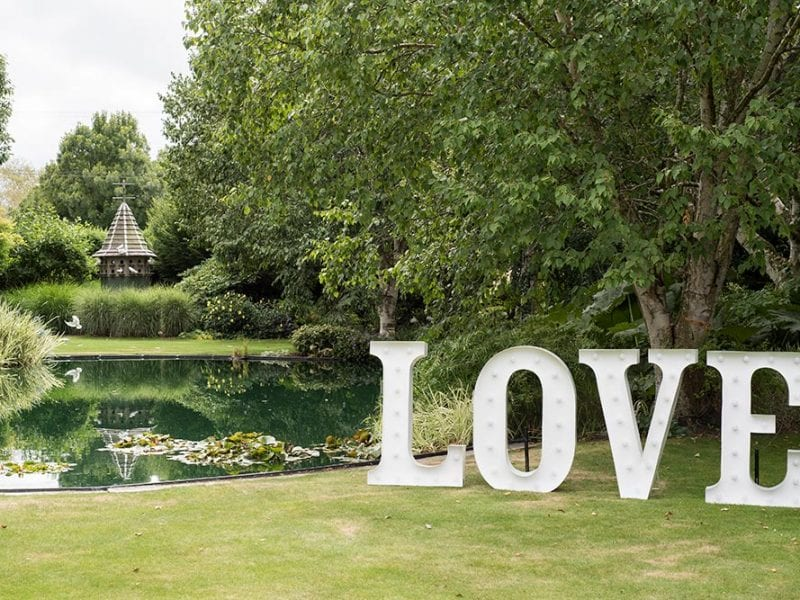 LOVE sign beside the water