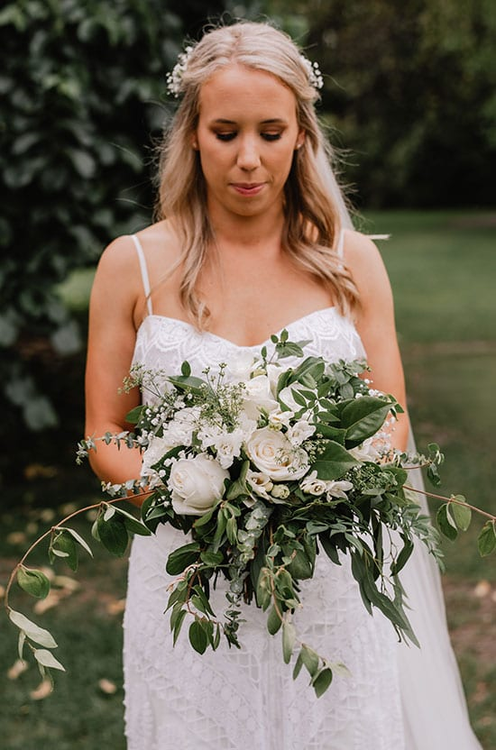 Beautiful bride with her bouquet by Kim Chan Events
