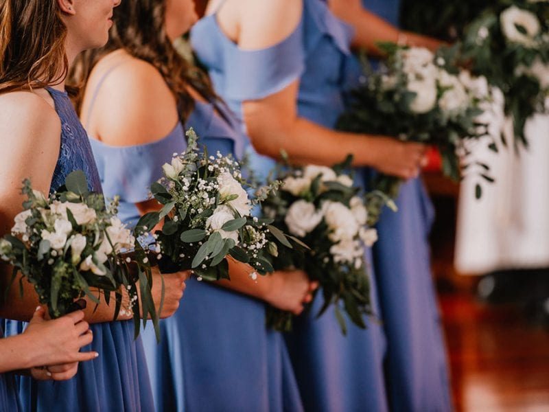 Bridesmaids with beautiful white and green themed bouquets