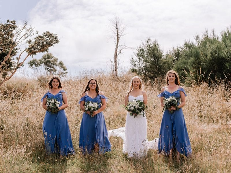 Claire and her bridesmaids with their bouquets