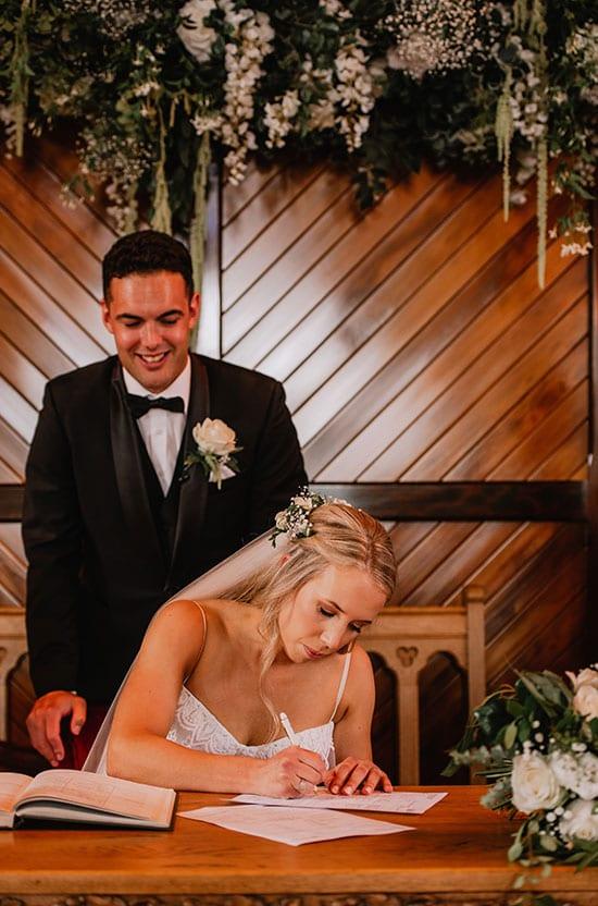 Gorgeous couple sign surrounded by elegant floral arrangements
